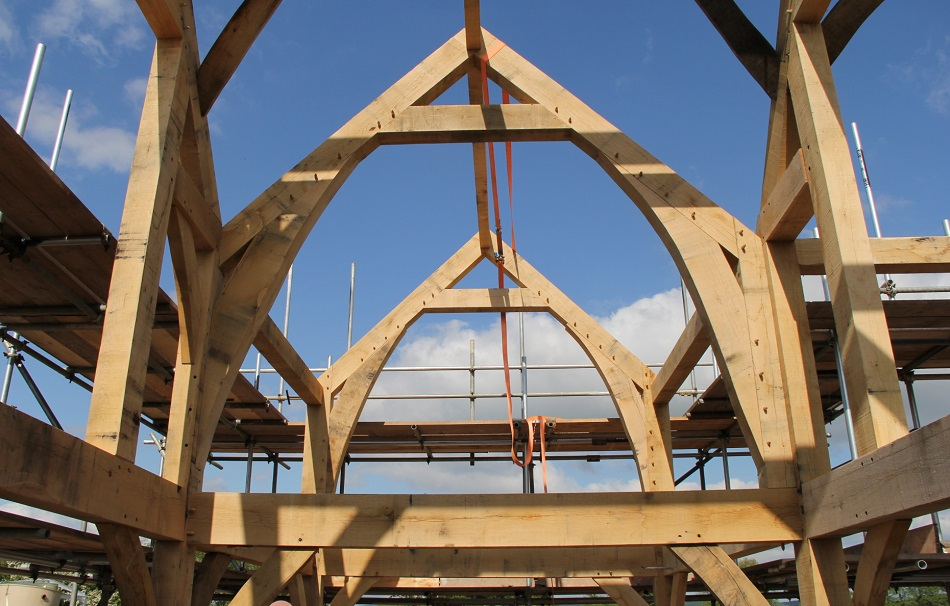 Curved sling braces oak frame